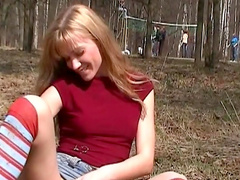 Hardcore blonde is masturbating her pussy outdoors