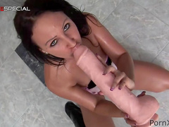 Suzy is fucking herself with giant dildo