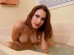 Big-titty brunette Nora Noir is penetrating her lovely snatch