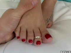Pornstar London Keys gives footjob