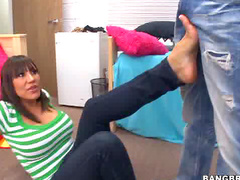 Busty Ava Devine gives footjob