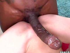 Redhead pleasured by huge cock