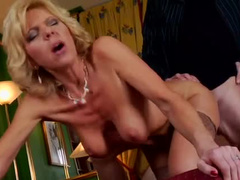 Yummy mummy takes young cock