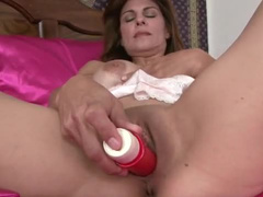 Red dildo enters milf snatch