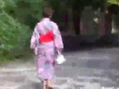 Japanese girls in kimonos outdoors