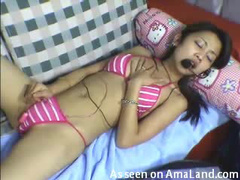 Asian girl dances sensually