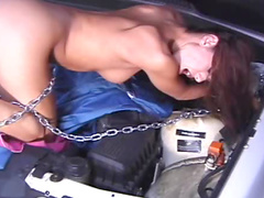 Inserting silver toy into her ass