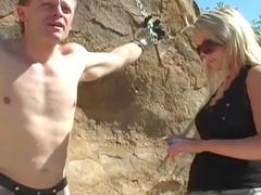 Blonde dominating over her tied slave