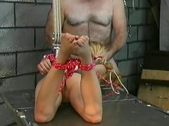 Collared Asian girl sucks dick in dungeon