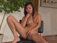 Asian cutie AG Lee is masturbating her pussy