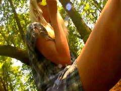 Hot blonde masturbates in woods