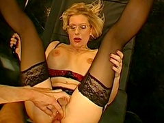 Blonde in glasses is swallowing and fingering