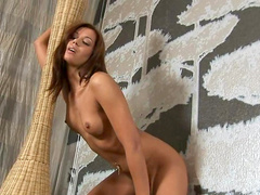 Tanned chick shows her nice ass and sticks a toy in her cunt