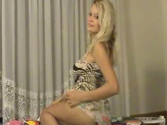 Pretty blonde Amber gets naked on the cam
