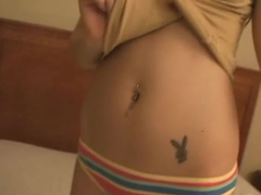 Hot brunette chick shows her navel piercing and tattoo