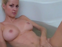 Pretty blonde Erica is a beauty in a bathroom