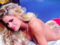 Blonde Jessa Rhodes is playing with a dildo
