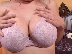 Kiki Daire is showing off her big boobies