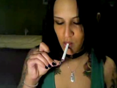 Brunette Regan Reese is smoking and teasing
