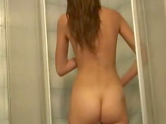 Shaved amateur takes a shower