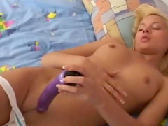 Girl bangs cunt with dildo