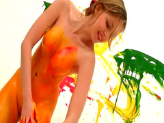 Teen covered in red paint