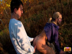 Blonde rides BF in field