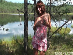 Redhead strips by the lake