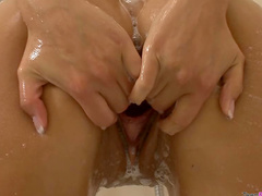 She washes pussy in shower