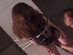 Asian beauty Asami Kaya is getting tied to a wall