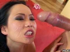 Smiling Asian Niya Yu and big cum load