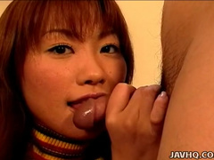 Cute Japanese wearing skirt gives a blowjob