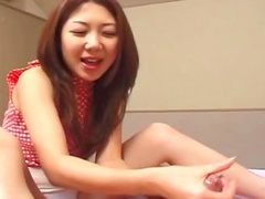 Cute Japanese is testing her handjob abilities