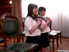 Asian schoolgirls are sucking hairy pussies
