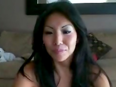 Adorable Asian chick puts a toy in her pussy on webcam