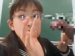 Sweet Asian is sucking dick in the classroom