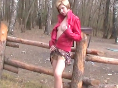 Stunning blonde is posing in the forest