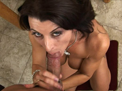 Shaved and tattooed milf sucks off cock