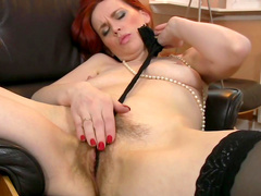 Cute redhead babe Mystique plays with her pussy