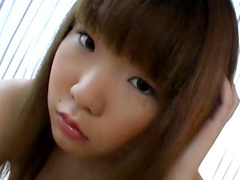 Slender Asian model is smiling in the cam