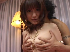 Guy touches Japanese girl's natural tits and trimmed pussy
