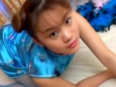 Solo Japanese girl Kusunoki Sayaka playing in her room