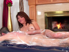Asian babe Lola is wanking that soapy dick