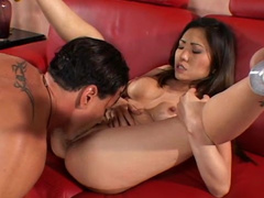 Sexy Asian chick is sucking this tasty prick