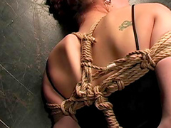 Young redhead in sexy rope bondage