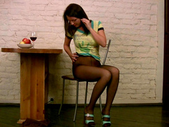 Black pantyhose make brunette teen sexy