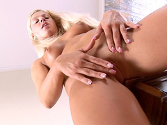 Slender blonde Candy Blond is fucking her shaved puss with pleasure