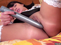 Busty one is poking her puss with dildo