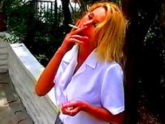 Blonde cutie smoking cigarette in amazing stockings