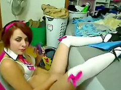 Redhead emo girl poses in her sexy uniform